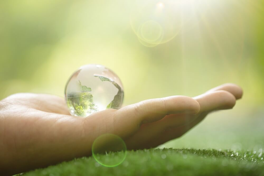 Close-up-of-green-planet-in-your-hands-save-earth